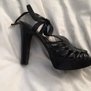 Platform style leather strapped